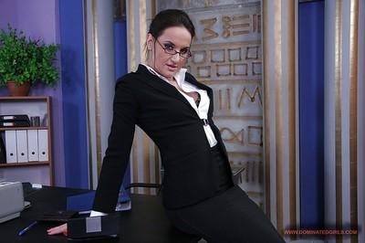 Sexy office babe in glasses Andy Brown stripping off her suit and lingerie