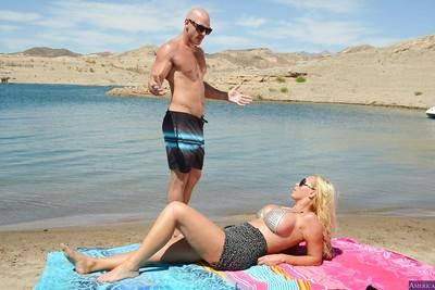 Awesome-looking blonde Nikki Benz is giving a great outdoor blowjob