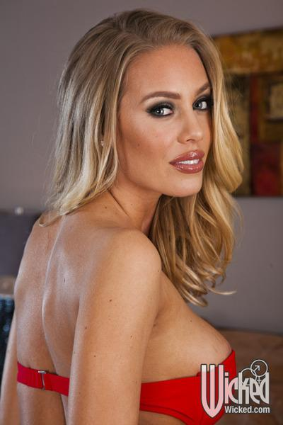 Seductive babe in lingerie Nicole Aniston stripping and spreading her legs