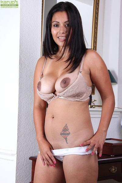 Busty and tattooed MILF Veronica flashing white underwear and natural boobs