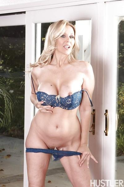 Leggy blonde pornstar Julia Ann flashing panties underneath dress