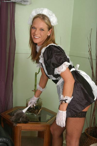 Frisky maid getting rid of her sexy uniform and black stockings