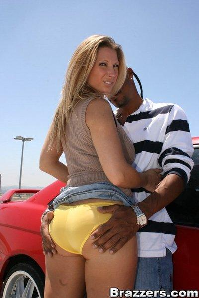 Busty MILF Devon Lee posing upskirt before taking a huge black cock
