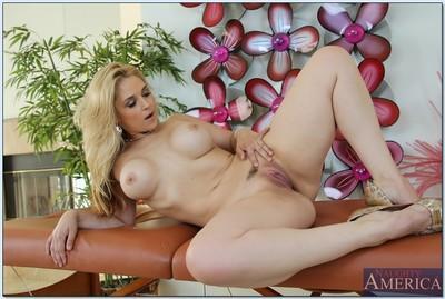 Curvaceous MILF Sarah Vandella stripping off her lingerie