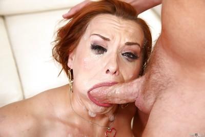 Older redheaded MILF Katja Kassin delivering a messy blowjob