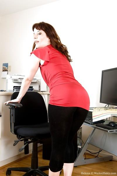 Horny secretary on high heels stripping and toying her bush in the office