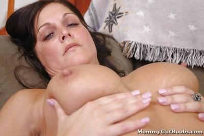 Big titted MILF housewife Jolee gets a boner in her horny cunt