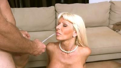 Shaved pussy of a slender milf Kasey Storm is nailed hard with a big cock