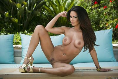 Seductive brunette Kirsten Price slipping off her pink bikini outdoor