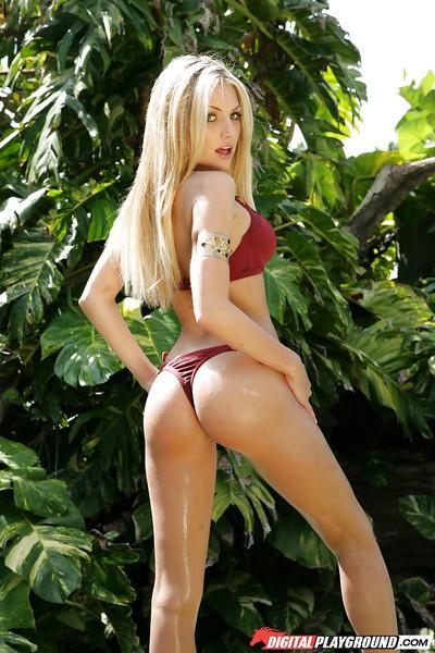 Big-tit blonde Teagan Presley is taking off her red panties outdoors