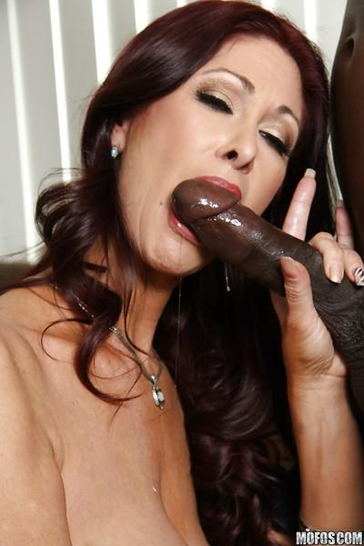 Seductive MILF in stockings Tiffany Mynx sucks and fucks a big black cock