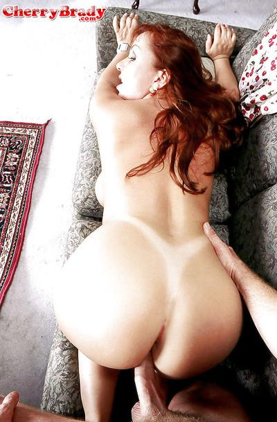 Busty redhead cougar Cherry Brady takes hardcore ass fucking after bj