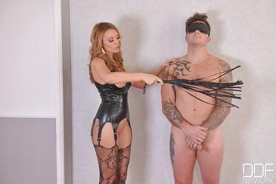 Blonde mistress Stacey Saran tossing her male slave