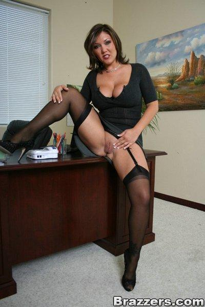 Big titted MILF Claire Dames strips and rubs pussy in her office