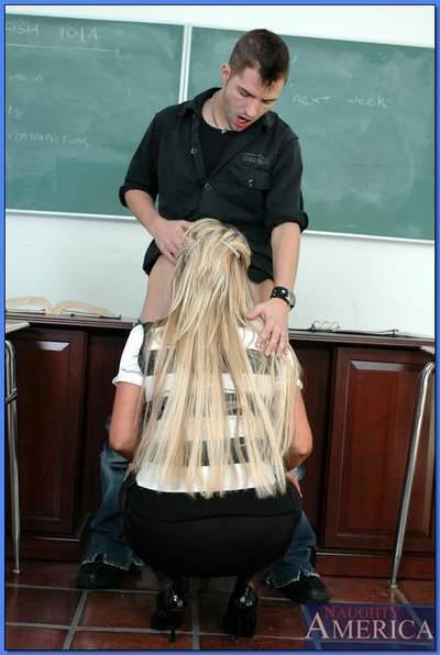 Blond MILF teacher in glasses and stockings pleasuring long dick