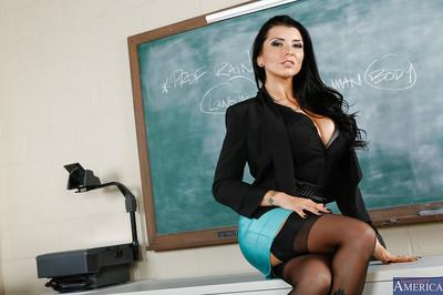 Jaw-dropping sexy teacher in nylons undressing and fingering her gash