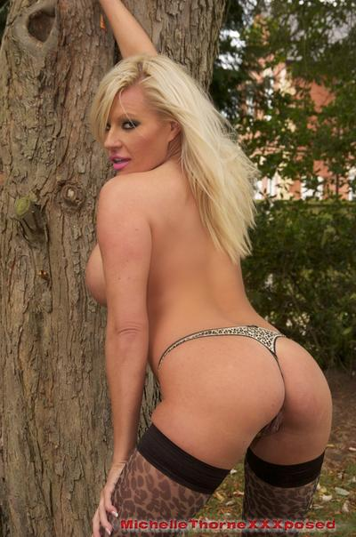 Outdoor posing scene with an outstanding milf babe Michelle Thorne