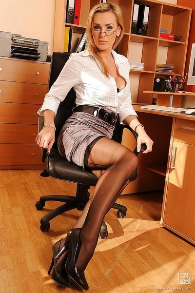 Seductive MILF Tanya Tate posing as a lustful office secretary