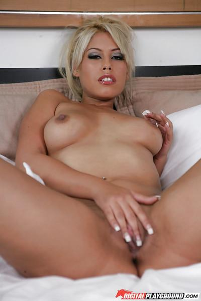 Awesome bleached Angelina Armani is showing off her boobies!
