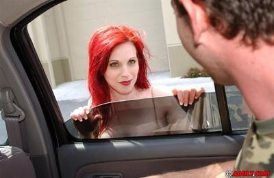 Slutty redhead cougar goes down on a stiff dick on the back seat