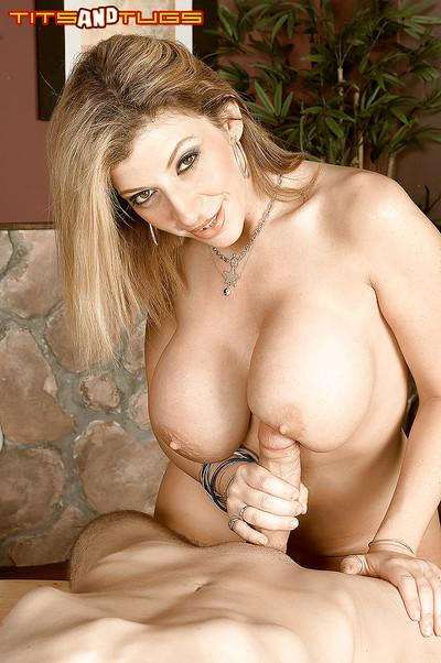 Busty MILF Sara Jay giving titjob for cumshot on large breasts