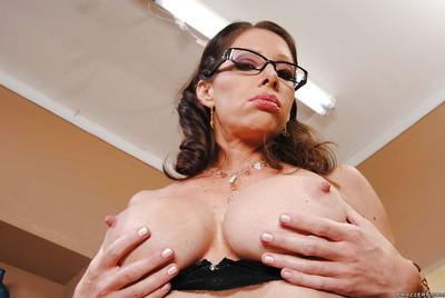 MILF babe in glasses Angel feels her nipples and shows pussy