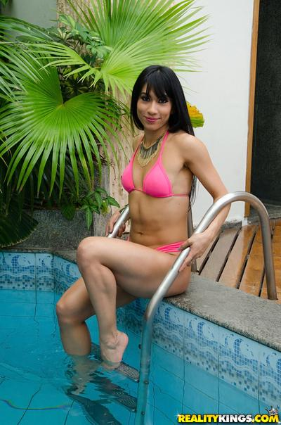 Posing by the pool Latina Rebecca Rios shows off her sexy assets