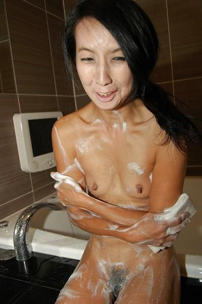 Skinny asian MILF with hard nipples taking shower and rubbing her soapy body