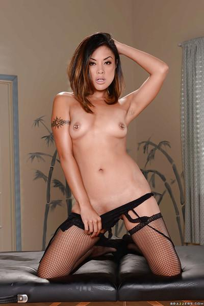 Tanned Asian beauty Kaylani Lei is masturbating her nice hot snatch