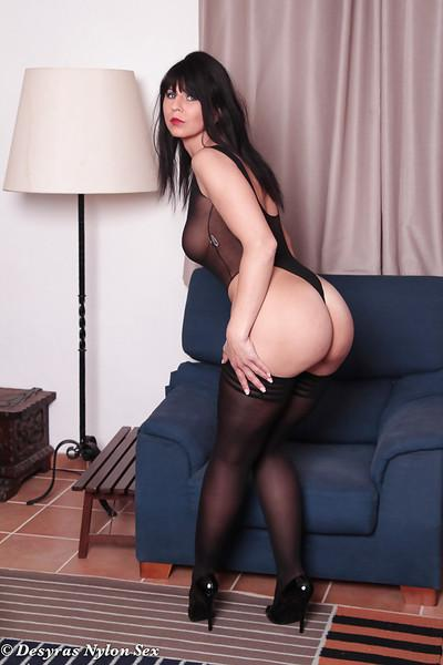 Sexy brunette mom Desyra Noir posing solo in see thru bodystocking