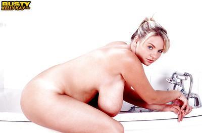 Chubby Euro babe Kelly Kay frees big pornstar juggs for nipple play in bath