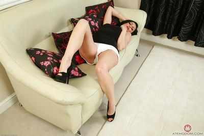 Brunette mommy Roxanne Cox pulling pink panties down MILF legs
