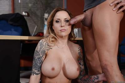 Pretty tattooed milf Payton West caresses clit while sucking huge bolt