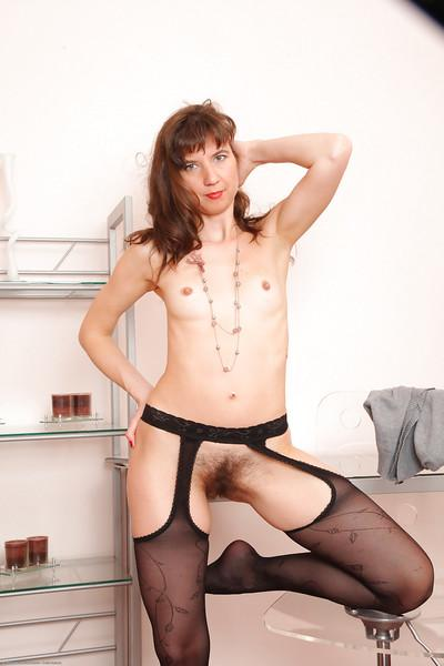 Stockings milf model Victoria is spreading her legs in black stockings