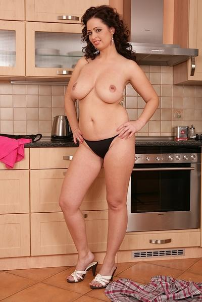 Busty older MILF Sirale exposing large natural tits in kitchen
