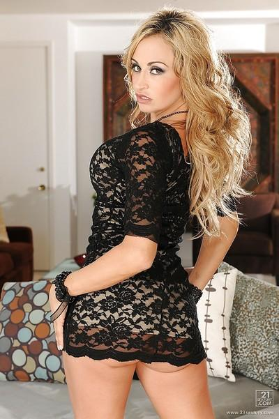 Hot MILF Claudia Valentine stripping off her lacy dress and lingerie