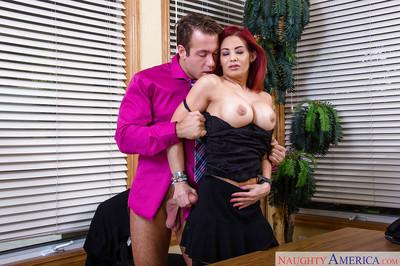 Redhead office milf Ryder Skye shows off her big boobies!