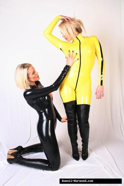 Non nude posing scene featuring Dannii Harwood and Lucy Zara in latex