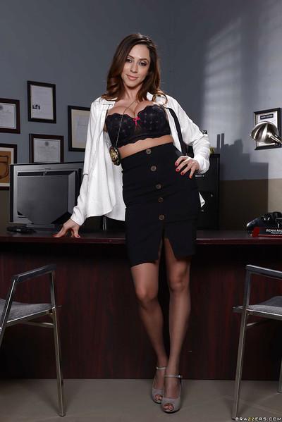 Brunette police secretary Ariella Ferrera showing off great legs in nylons