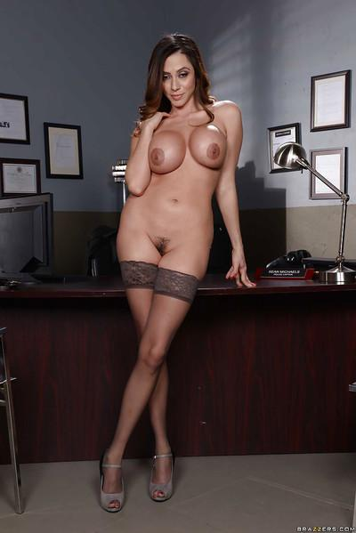 Brunette police secretary Ariella Ferrera showing off great legs in nylons
