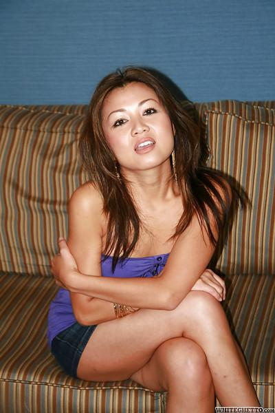 Playful asian MILF in jeans miniskirt undressing and spreading her legs