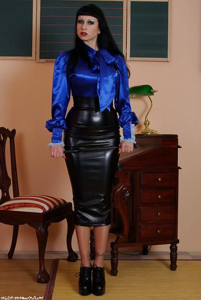 Fully clothed fetish MILF exposing her ample ass covered with latex skirt