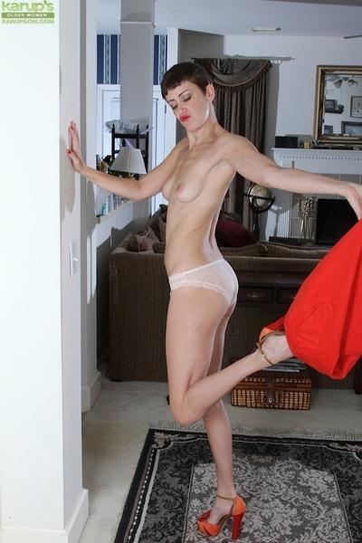 Skinny brunette solo girl Stevie Jones baring tight MILF ass and tits