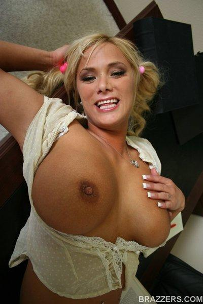 Busty MILF Shyla Stylez shows her gorgeous boobs and her stunning body