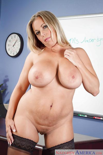 Busty Milf teacher Amber Lynn Bach in high heels licks own nipples