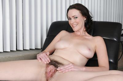 Clothed milf beauty Veronica Snow showing her hairy pussy