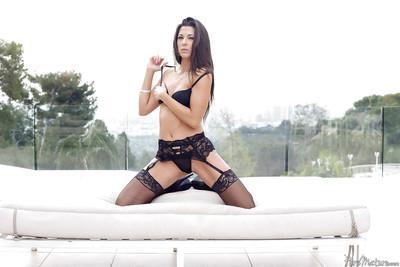 Hot babe Alexa Tomas modelling black nylons and high heels outdoors