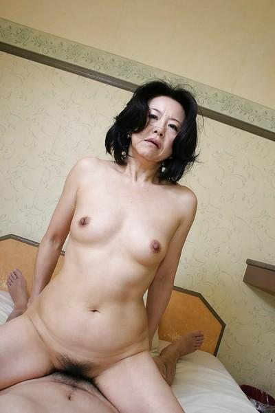 Lusty asian MILF Junko Sakashita has some pussy fingering and fucking fun