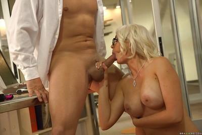 Hot blonde secretary in glasses Gigi Allens receiving oral sex on desk