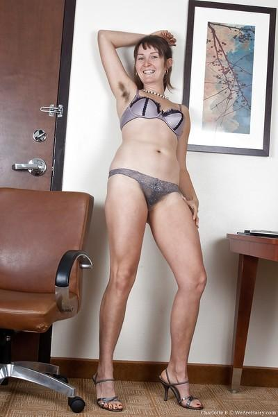 Filthy MILF with hairy armpits and bushy cunt stripping in the office